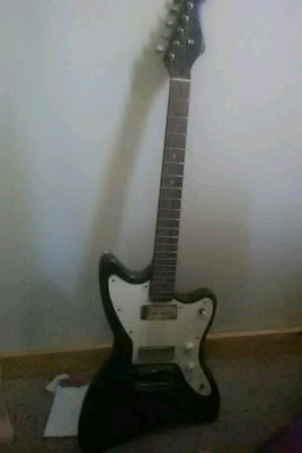 white and black electric guitar