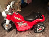 Toddler's red and black ride on atv.