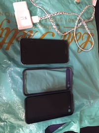 black Android smartphone with two cases Surrey, V3T 4Y8