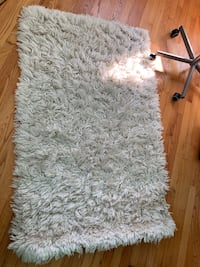 White and gray fur textile carpet. I have two of them $20 each Bethesda, 20814