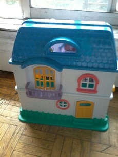 white and blue 2-storey house toy