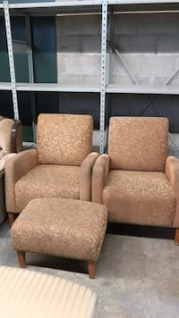 two brown fabric sofa chairs