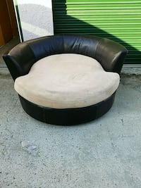 Round leather ottoman. OBO Spring Valley, 91978
