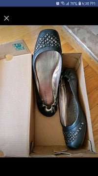 pair of black leather flats Toronto, M6N 3W7
