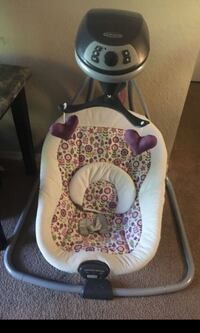 Baby's white and gray graco cradle and swing Orlando, 32818