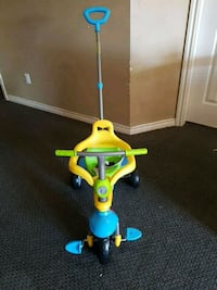 toddler's yellow and blue push trike Surrey, V3Z