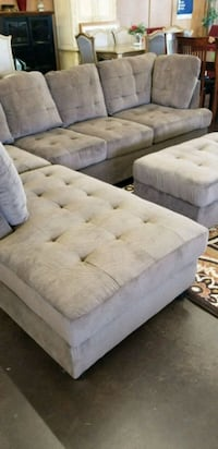 Brown fabric sectional with a matching storage ott