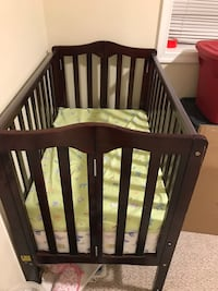 baby's brown wooden crib Springfield, 22150