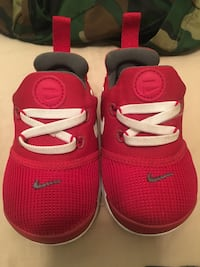 Pair of red nike basketball shoes Edmonton, T5G 0S7