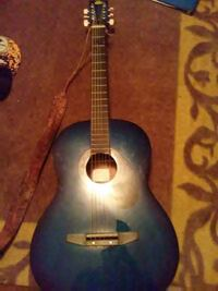 blue and black dreadnought acoustic guitar