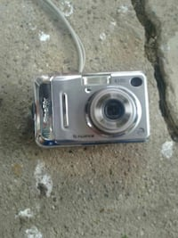 gray Fujifilm point and shoot camera
