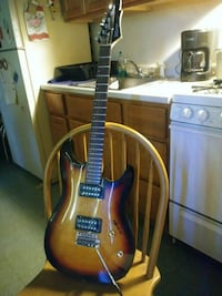 brown and blue electric guitar Woonsocket, 02895