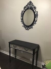 """Stylist mirror black with fine white detailing giving it yesterday's charm.  Dimensions are 33"""" x 28"""" St Catharines, L2P 3K9"""