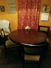 round brown wooden table with four chairs dining set Petal, 39465