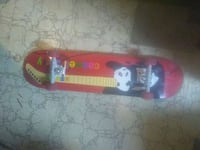 red and black skateboard deck Calgary, T2E 7A9