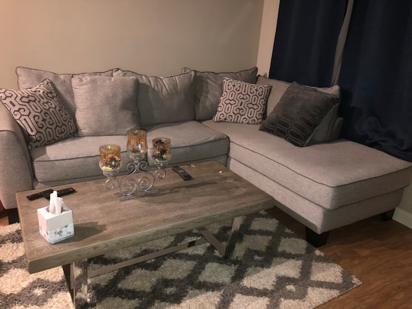 Used gray fabric sectional sofa with throw pillows for sale in ...