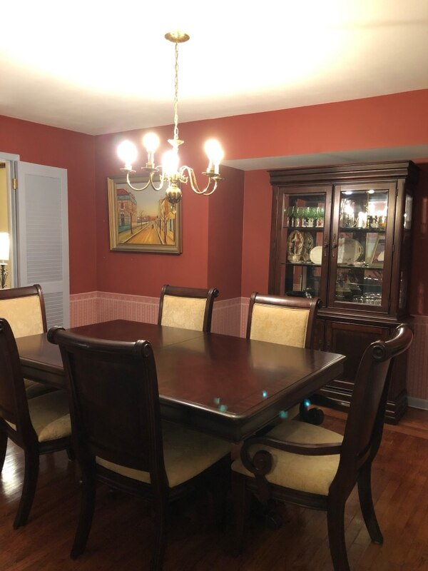 Cherrywood dining room table with six chairs, matching china cabinet and  protective table pads
