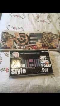 Poker set with case cards chips and wallpaper boarder ! New in box never open . For your game room 439 mi