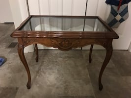 rectangular brown wooden framed glass top table