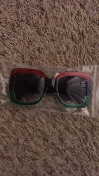 two black and green framed sunglasses Red Deer, T4P 2X6