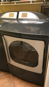 Black and gray front-load clothes washer Castro Valley, 94552