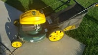 yellow and green Craftsman push mower Colton