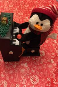 Christmas Animated Lightup Musical Penguin plays piano