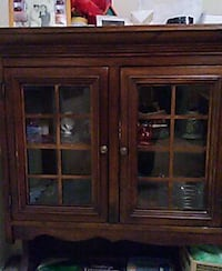 brown wooden and glass cabinet Falls Church, 22042