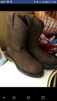 pair of brown leather cowboy boots 255 mi