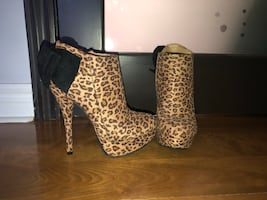 NEGOTIABLE Size 7 Leopard Print High Boot Stiletto Heels with Black Bow