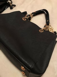 black leather crossbody bag with silver studs Montréal, H2Y