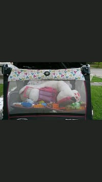 white and pink floral travel cot screenshot Tampa, 33607