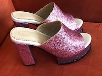 pair of white-and-pink slip on shoes