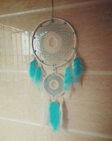 teal and white dreamcatcher
