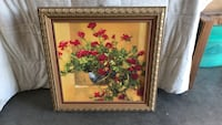 red flowers in vase painting with brown frame