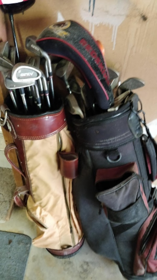 2 sets of golf clubs/drivers