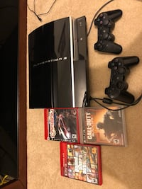 black Sony PS3 game console with controllers and game cases Pittsburgh