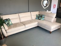 white leather sectional sofa with throw pillows THORNHILL
