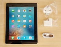 black iPad with white charger Kamloops