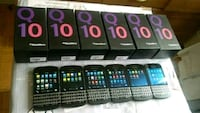 six black Blackberry QWERTY smartphone with boxes