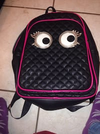 black and pink leather backpack