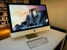 silver Imac with keyboard and magic mouse