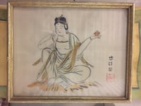 brown wooden framed painting of Buddha