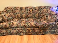 gray and green floral 3-seat sofa null