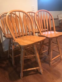 Four brown wooden bar height chairs 283 mi