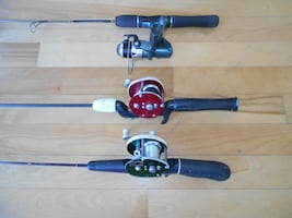 3 Winter ice fishing rods and reels ready to fish