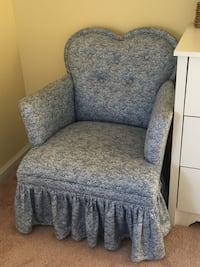 gray and blue floral fabric sofa chair null