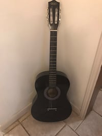 black classical guitar with gig bag Spring, 77380