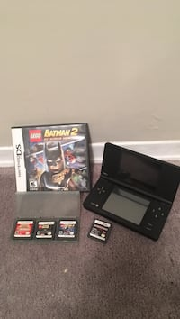 Black nintendo ds with game cartridges Richmond Hill, L4C 9Y9