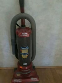 red and black Bissell upright vacuum cleaner Tomball, 77377